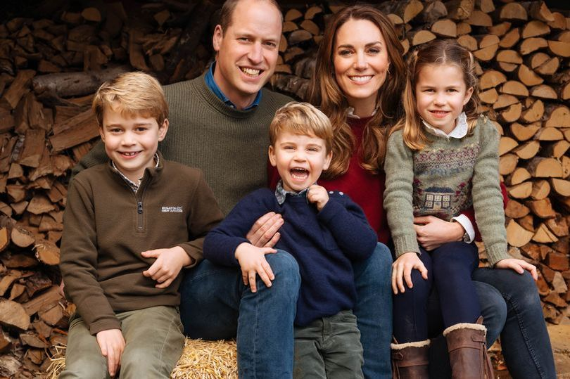 Kate Middleton and her husband Prince William pose with their three adorable children. (