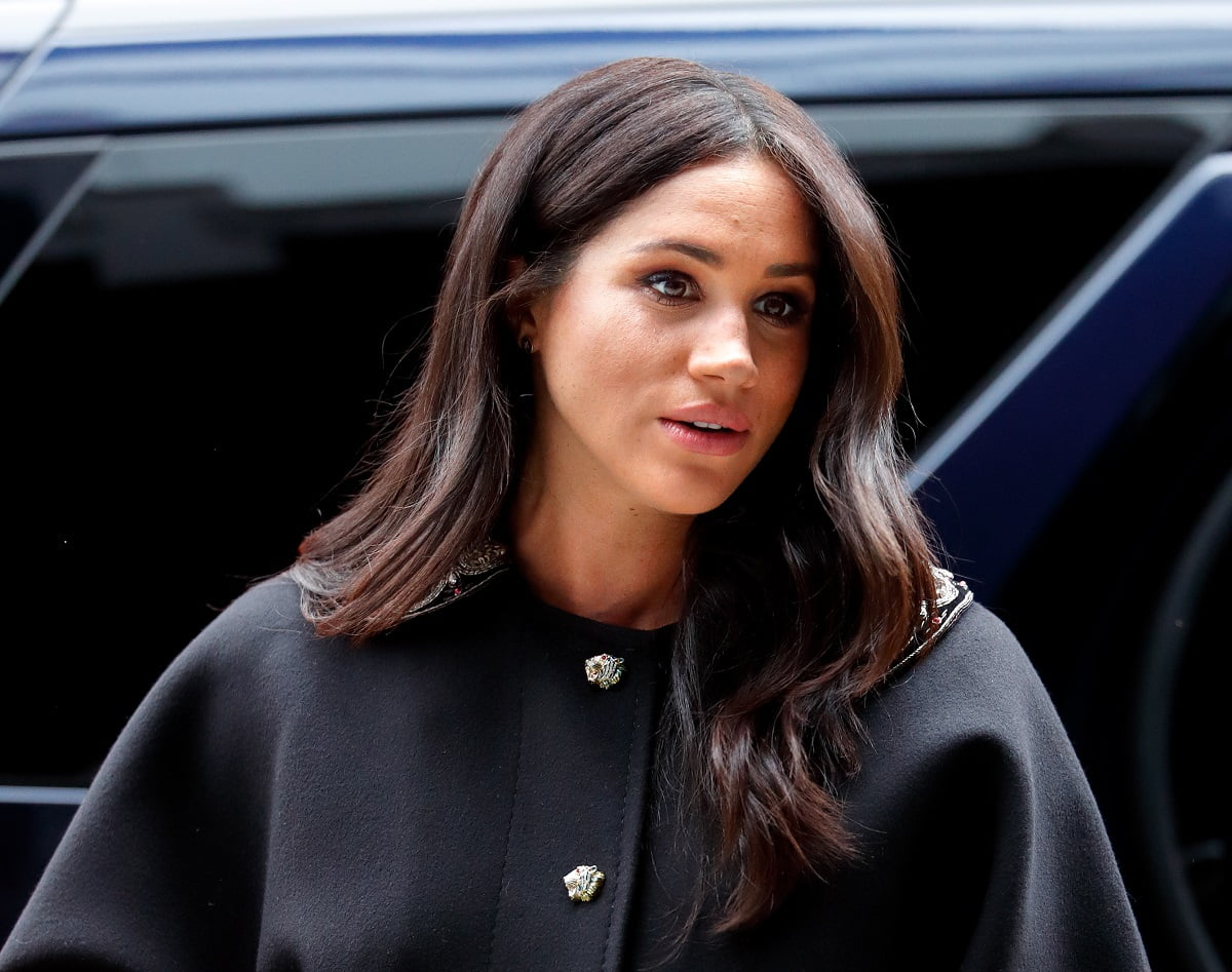Meghan Markle wearing a black coat on a visit to New Zealand House   Max Mumby/Indigo/Getty Images